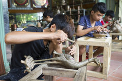 Junior craftsmen making copper handicraft products in traditional way Royalty Free Stock Photo