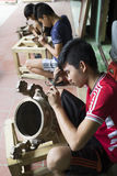 Junior craftsmen making copper handicraft products in traditional way Royalty Free Stock Photography