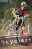 Junior Cyclocross Racer Trips Over Barrier Stock Photography