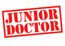 JUNIOR DOCTOR. Red Rubber Stamp over a white background Royalty Free Stock Photos