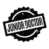 Junior Doctor rubber stamp. Grunge design with dust scratches. Effects can be easily removed for a clean, crisp look. Color is easily changed Stock Photos