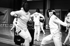 Junior epee fencing bout royalty free stock photo