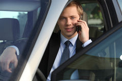 Junior executive driving luxury car Stock Photos