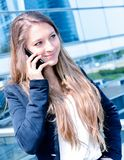 Junior executive dynamic phoning outside of her office Royalty Free Stock Photos