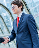 Junior executives dynamics shaking hands Royalty Free Stock Photo