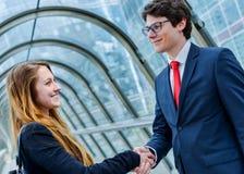 Junior executives dynamics shaking hands Royalty Free Stock Photography