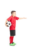 Junior football player gesturing displeasure. Full length portrait of a junior football player gesturing displeasure isolated on white background Royalty Free Stock Image