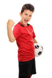 Junior football player with gripped fist Stock Photo