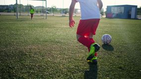 Junior football players dribble ball running to goal. With goalkeeper during soccer training low angle shot stock video
