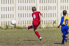 Junior Football Strike Goal Royalty Free Stock Image