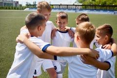 Junior Football Team nell'unità fotografia stock
