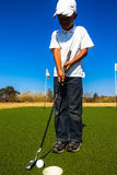 Junior Golf Putting imagem de stock royalty free