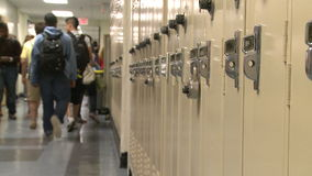Junior High students walking down hall by lockers (3 of 7)