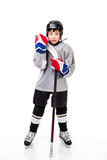 Junior Ice Hockey Player Isolated on White Background. Junior ice hockey player with full equipment and uniform isolated on white background Stock Photography