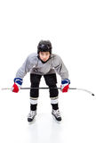Junior Ice Hockey Player Isolated on White Background. Junior ice hockey player with full equipment and uniform isolated on white background. In faceoff stance Royalty Free Stock Images