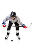 Junior Ice Hockey Player Isolated on White Background. Junior ice hockey player with full equipment and uniform isolated on white background. In faceoff stance Royalty Free Stock Image