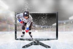 Junior Ice Hockey Player sur 3D vivant TV à l'intérieur de stade image libre de droits