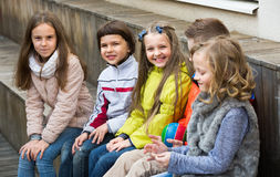 Junior kids chatting outdoor Royalty Free Stock Photos