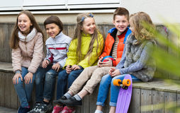 Junior kids chatting outdoor Royalty Free Stock Image