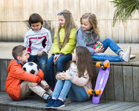 Junior kids chatting outdoor Stock Image