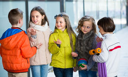 Junior kids chatting outdoor. Happy smiling junior school children chatting outdoors Stock Image