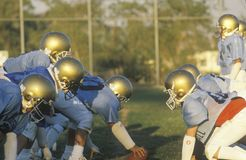 Junior League Football. Practice with team members on scrimmage line, Brentwood, CA Stock Images