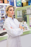 Junior pharmacist with arms crossed Stock Photo