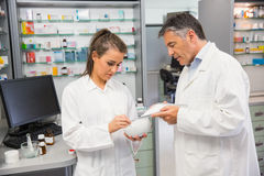 Junior pharmacist mixing a medicine with her senior Royalty Free Stock Photo