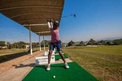 Junior Player Golf Practice Swinging Focus Royalty Free Stock Photography