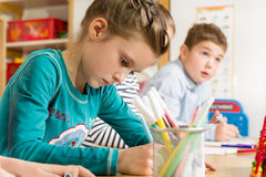 Junior pupils drawing with highlighters Royalty Free Stock Images