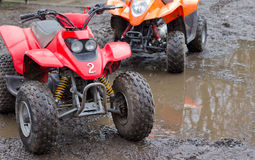 Junior quad bikes. Two quad bikes ready for action in the mud Royalty Free Stock Photo