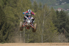 Junior quad racer is jumping over the horizon Stock Images