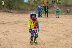 Junior after the race. SERPUKHOV, RUSSIA - OCTOBER 7, 2017: Junior after the race,  Class ATV-JUNIORS, in the 4 stage  MX series, the Red Wings Cup 2017 super Stock Images