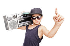 Junior rapper carrying a ghetto blaster and gesturing Royalty Free Stock Photos