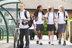 Junior school children leaving school royalty free stock photo