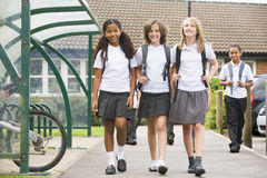 Junior school children leaving school stock image