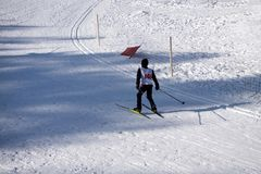 Junior ski downhill competition is held annually on the snowy ski slopes of the roller Coaster city winter ski resort. Children sk. Iers are going to start at Stock Photography