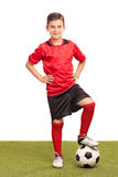 Junior soccer player stepping over a ball Royalty Free Stock Photography