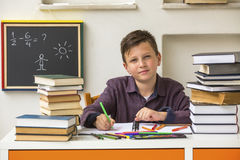 Junior student does homework. Education. Stock Photos