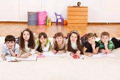 Junior students drawling Royalty Free Stock Image