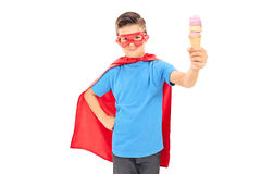 Junior in superhero costume holding an ice cream Stock Photo