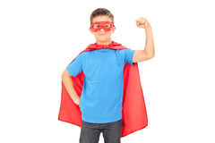 Junior superhero holding his fist in the air Royalty Free Stock Photography