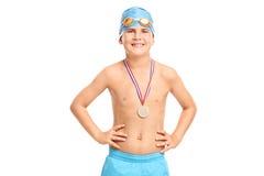 Junior swimming champion in blue swim trunks Stock Image