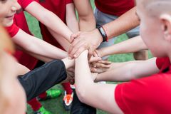 Junior Team Joining hands Royalty Free Stock Photo