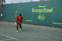 Junior Tennis Tournament Orange Bowl Boys. A junior tennis player hits a backhand return and  competes at the prestigious ITF Junior Orange Bowl championship Royalty Free Stock Photos