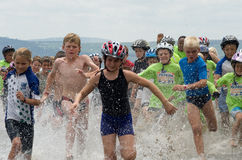 Junior triathlon runners at aQuelle Mudman Series Royalty Free Stock Photography