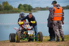 Juniors before start. SERPUKHOV, RUSSIA - OCTOBER 7, 2017: Juniors before start,  Class ATV-JUNIORS, in the 4 stage  MX series, the Red Wings Cup 2017 super Stock Photography