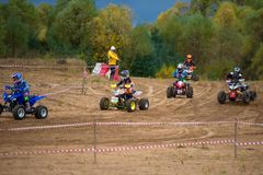 Juniors on the track. SERPUKHOV, RUSSIA - OCTOBER 7, 2017: Juniors on the track,  Class ATV-JUNIORS, in the 4 stage  MX series, the Red Wings Cup 2017 super Stock Photos