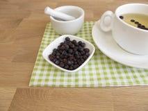 Juniper berries tea and dried juniper berries royalty free stock photos