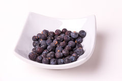 Juniper berries. On a white background, studio isolated Royalty Free Stock Images